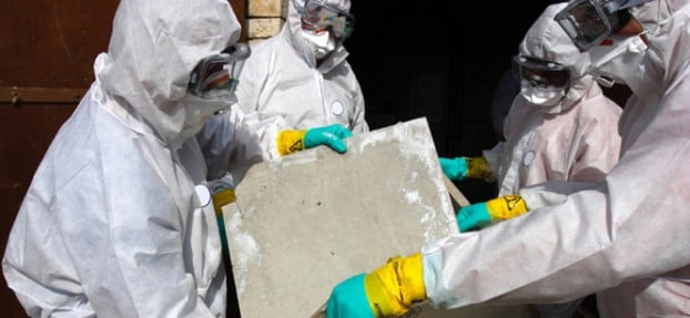People in white suits removing asbestos